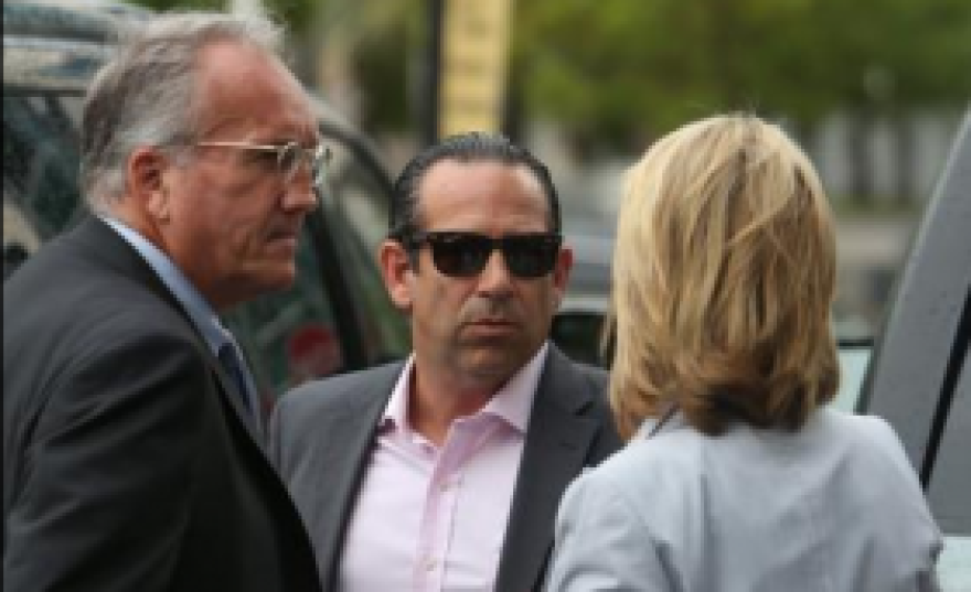 Anthony Bosch, middle, outside federal court in downtown Miami on Wednesday, September 3, 2014 with his attorneys. Bosch will plead guilty in October to charges of selling illegal steroids to professional and high school baseball players.