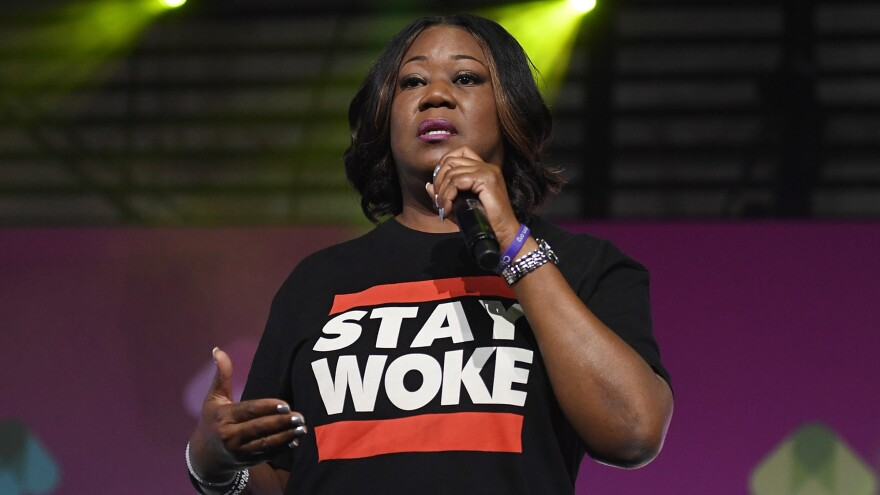 """""""This tale defies logic,"""" Trayvon Martin's family said on Wednesday after George Zimmerman filed a lawsuit against the family. Sybrina Fulton, mother of Martin, is seen here delivering a speech in 2017."""
