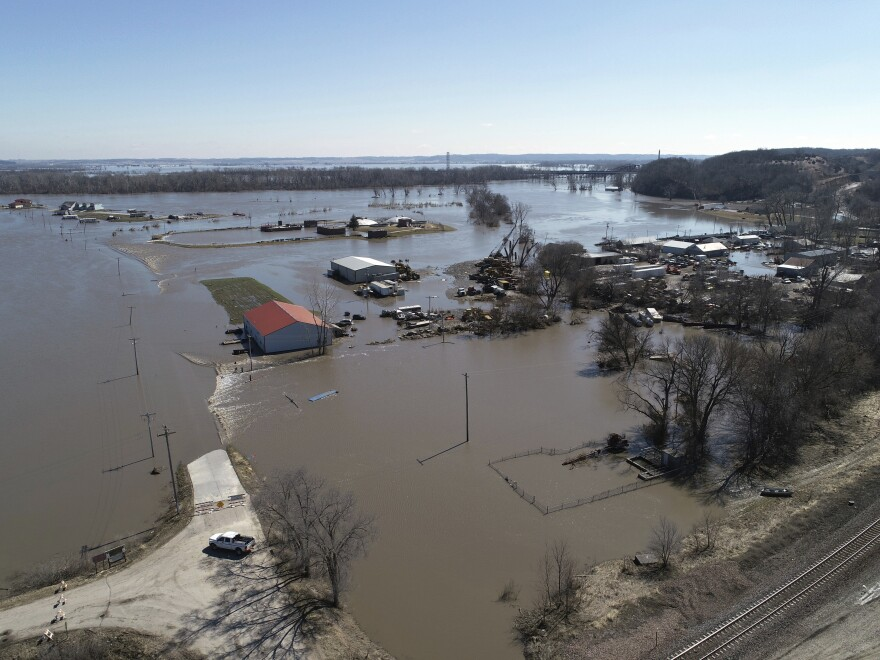 This Wednesday aerial photo shows flooding near the Platte River in in Plattsmouth, Neb., south of Omaha.