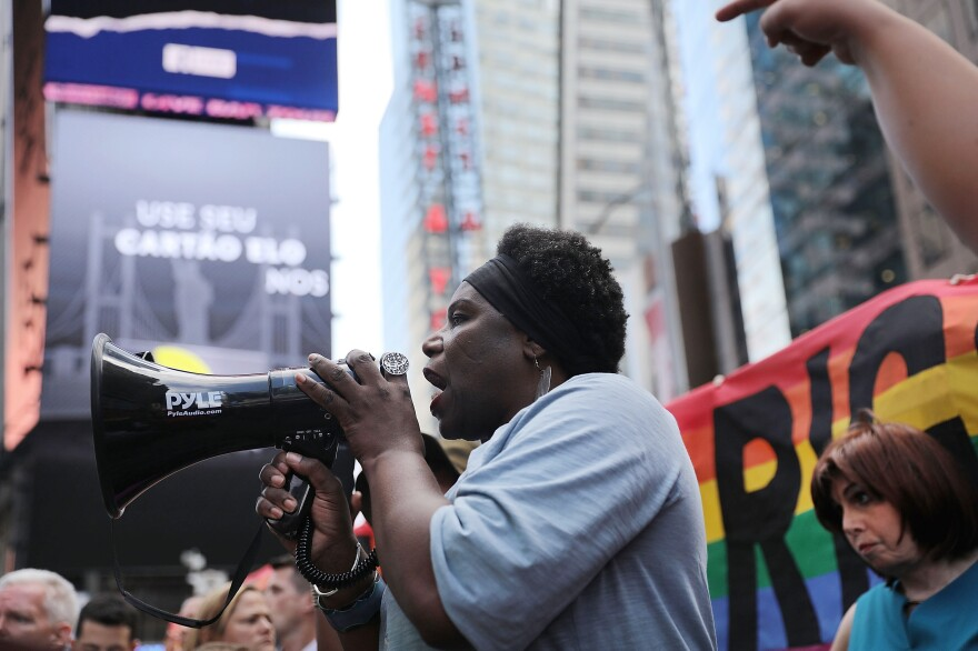 Transgender Army veteran Tanya Walker addressed protesters in New York's Times Square on July 26, 2017. The demonstrators had gathered near a military recruitment center, angry at Trump's decision to reinstate a ban on transgender individuals from serving in the military.
