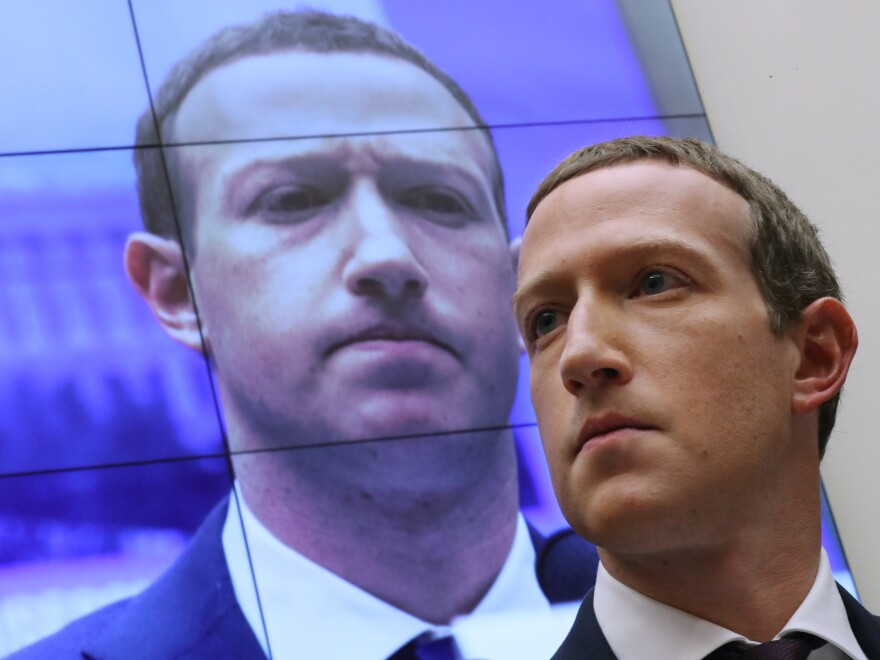 Facebook CEO Mark Zuckerberg testifies before the House Financial Services Committee in 2019. His company has been hit with twin lawsuits alleging it abused its power to crush rivals.