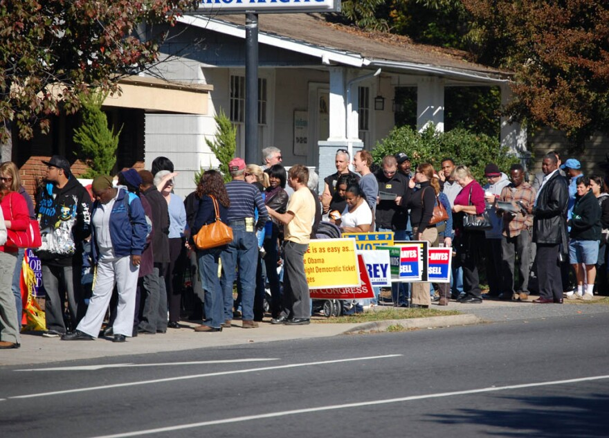 A line of voters waits outside the Plaza Midwood Library in 2008.