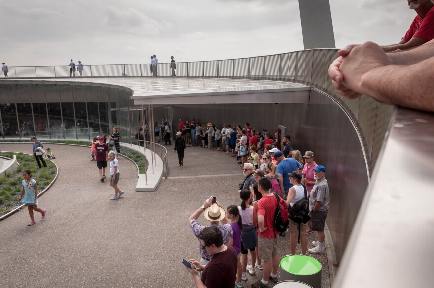 Visitors wait in line to enter the Gateway Arch museum and visitor center for the first time Tuesday after it re-opened following a five-year renovation. July 2018
