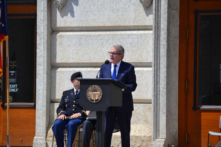 A photo of Mike DeWine speaking at the wreath laying ceremony at the Ohio Statehouse