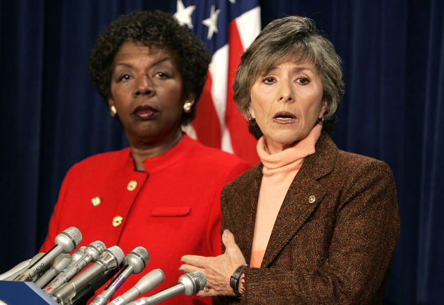 Sen. Barbara Boxer, D-Calif., speaks as Rep. Stephanie Tubbs Jones, D-Ohio, listens during a news conference to announce their objection to the certification of Ohio's electoral votes in January 2005.