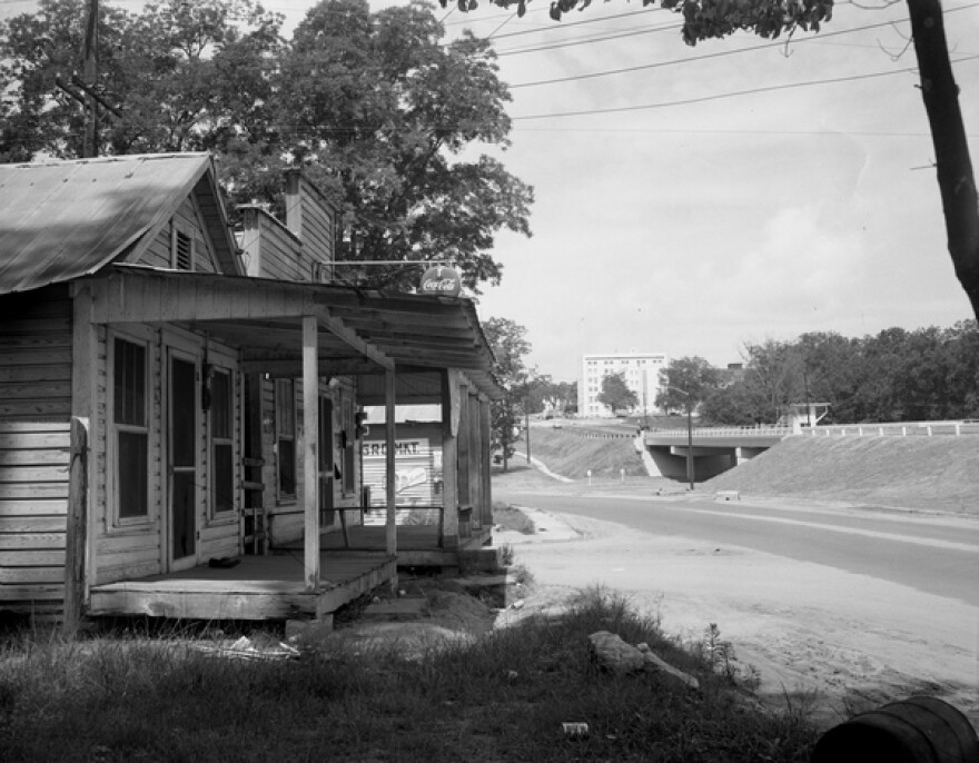 Old houses sit with Apalachee Parkway in the background, circa 1960's