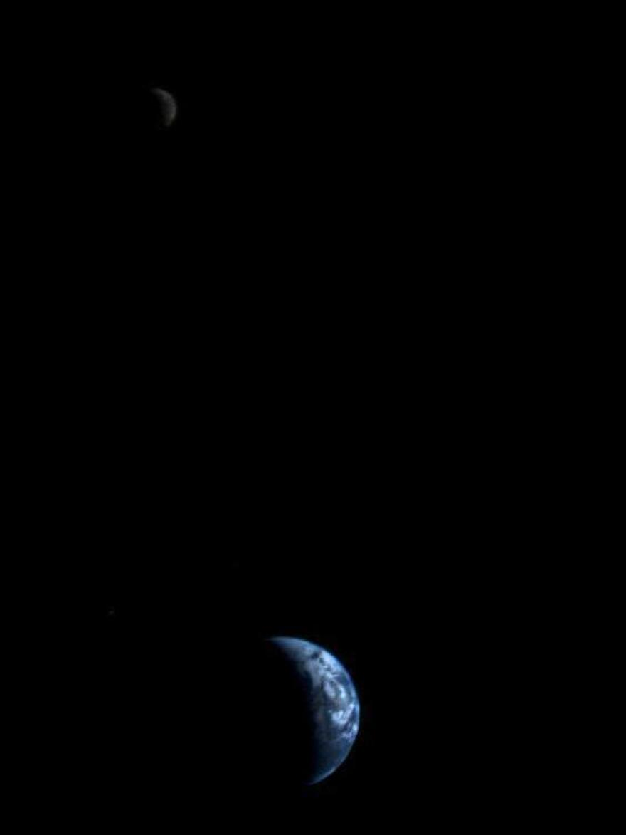 This image of the Earth and moon (upper left) in a single frame, the first of its kind ever taken by a spacecraft, was recorded by Voyager 1 on Sept. 18, 1977.