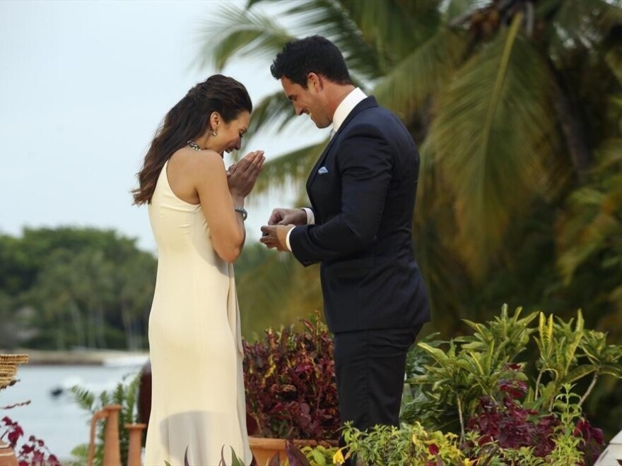 Andi gasps while accepting a proposal from Josh Murray (right, in the ill-fitting suit) on Monday night's finale of <em>The Bachelorette</em>.