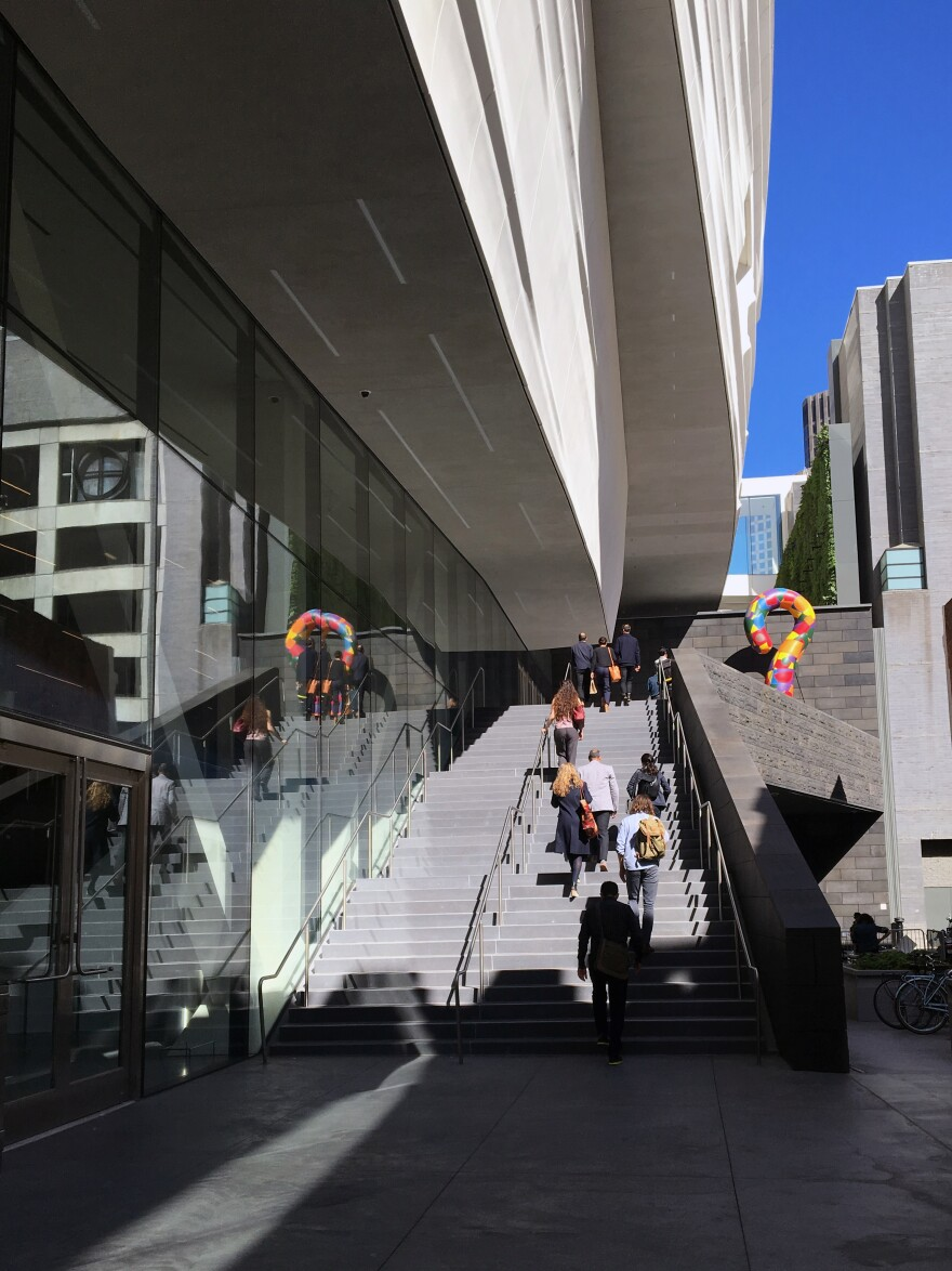 People walk up to the entrance to the new SFMOMA.