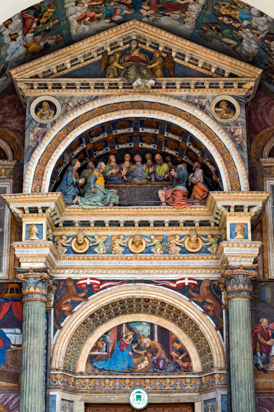 Finding goiter among the painted characters in the gorgeous exterior portal of the Aosta Cathedral in Aosta, Italy, isn't easy. Hint: Check the Nativity scene.