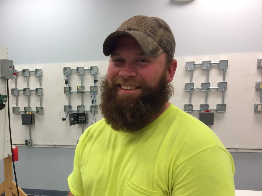 Brandon Woods, 31, is an apprentice with the local IBEW. He voted for Donald Trump despite union appeals to support Clinton.