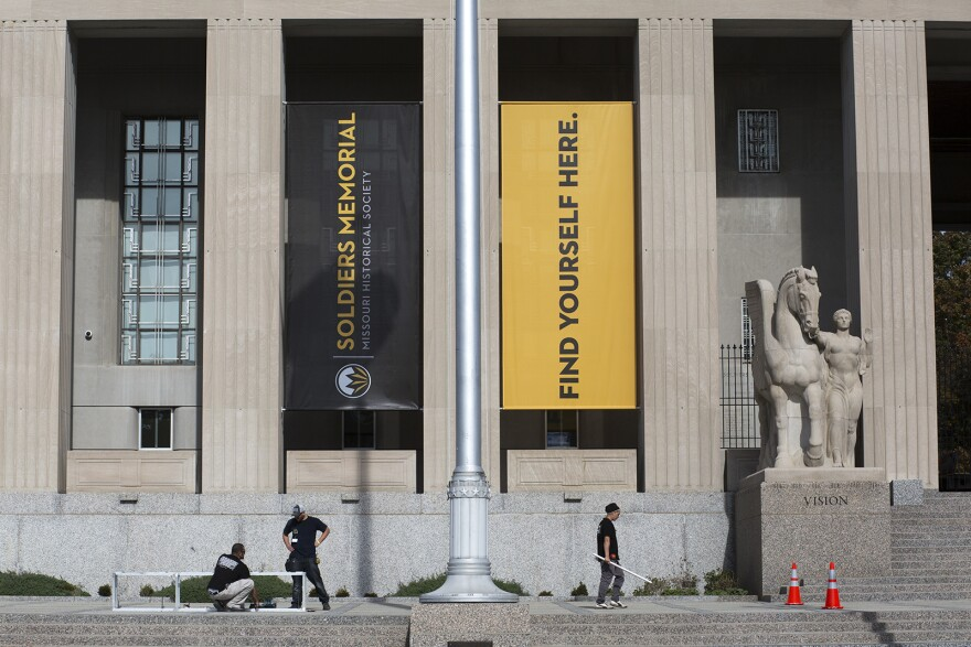 Workers prepare the Soldiers Memorial Military Museum for its upcoming re-opening event.