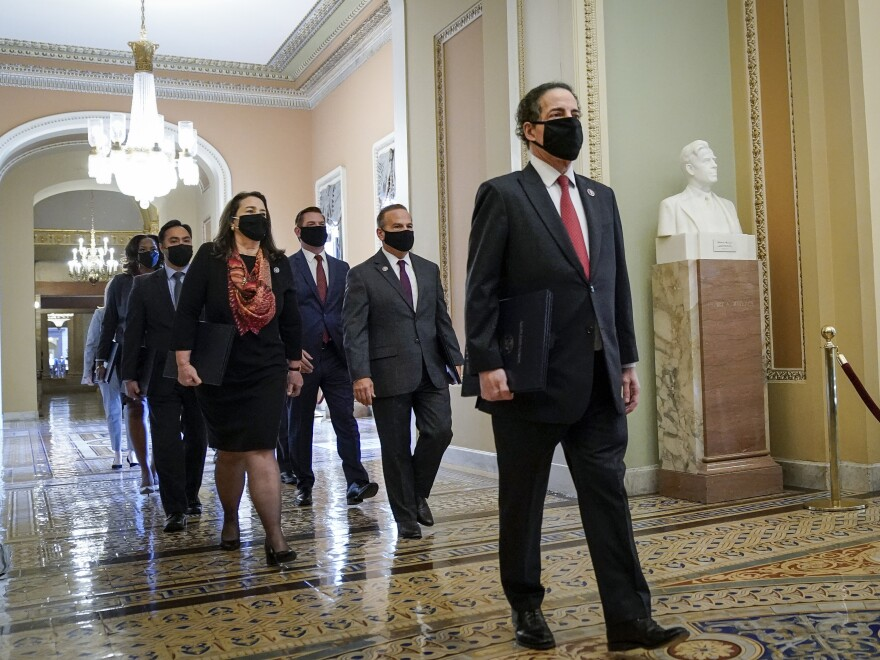 Led by lead manager Rep. Jamie Raskin, D-Md., House impeachment managers walk to the Senate Chamber on the first day of former President Donald Trump's second impeachment trial.