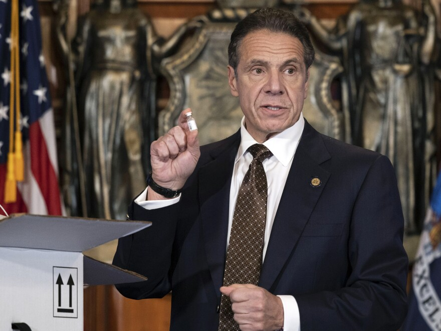 "Gov. Andrew Cuomo is urging New Yorkers to get the coronavirus vaccine when it becomes available to them. ""This is not only an individual responsibility; it is a community obligation,"" he said. Cuomo is seen above holding a sample of empty packaging for the COVID-19 vaccine during a news conference in Albany last month."
