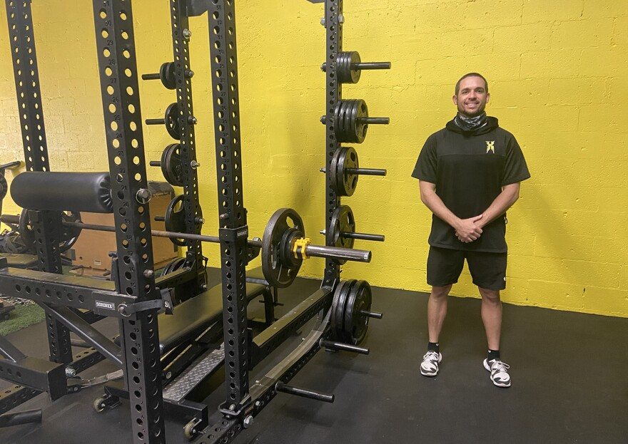 Daniel Marks standing next to gym equipment