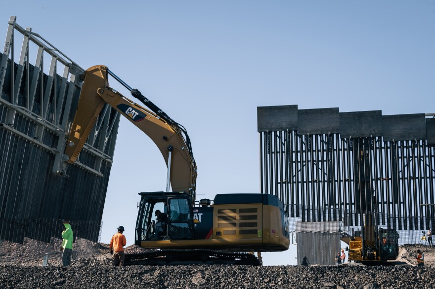 Fisher Industries workers move sections on May 24, 2019 in Sunland Park, N.M., near International Boundary Monument No. 1 where New Mexico, Texas and Mexico come together.
