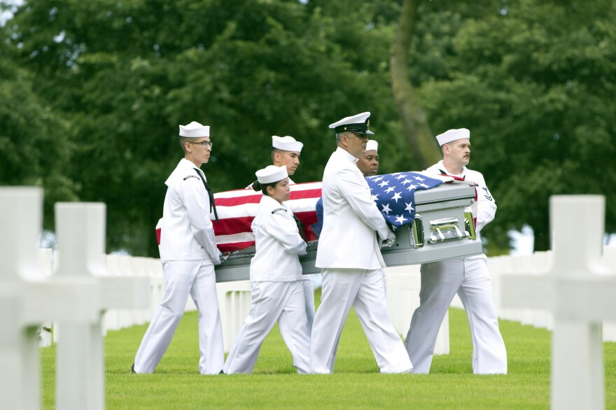 "U.S. Navy personnel carry the casket of World War II sailor Julius ""Henry"" Pieper during a reburial service at the Normandy American Cemetery, Colleville-sur-Mer, France, on June 19. Seventy-four years to the day after their ship hit a mine off the coast of Normandy and sank, the soldier's remains were finally reunited with, and laid to rest beside, his twin brother Ludwig ""Louie"" Pieper."
