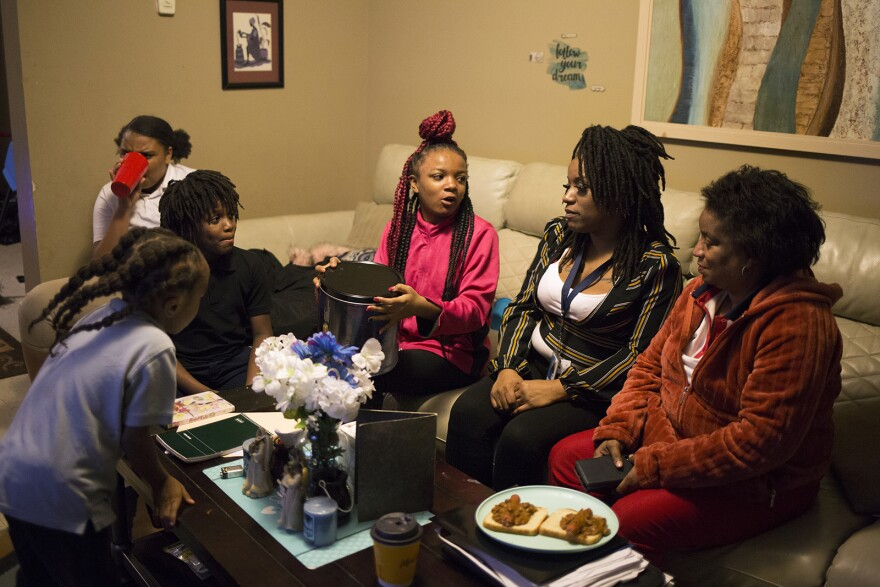 Gloria Hicks (right) eats dinner with daughter Kianna Hicks (second from right) and Kianna's children, (from left) Nicholas, Melvin, Anajah and Khanyla, at their home in East St. Louis on Jan. 21, 2020.