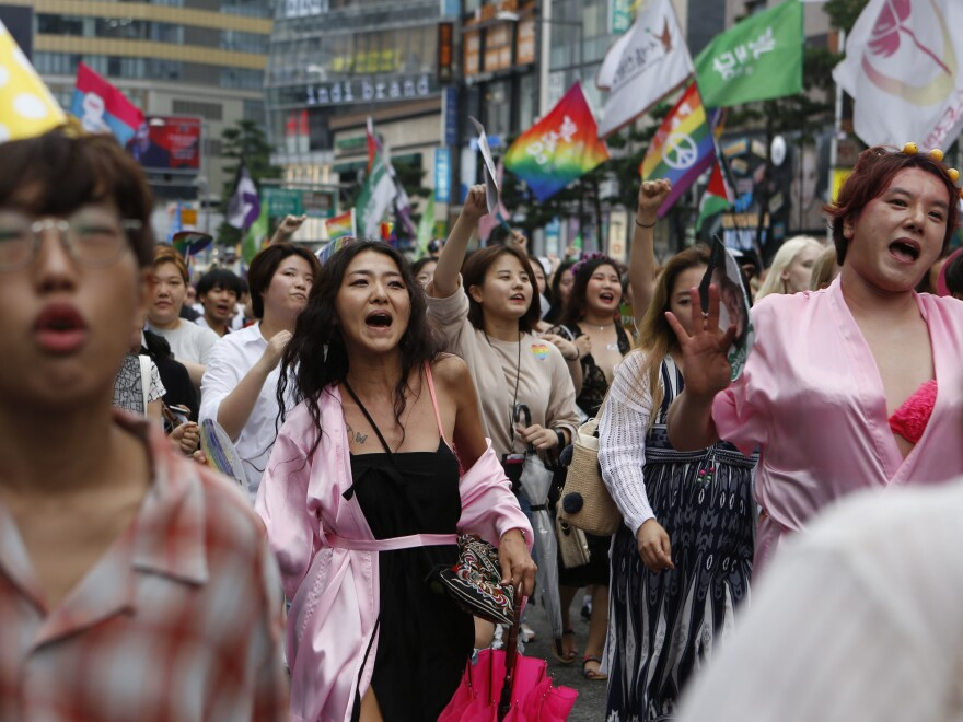 """LGBT pride celebrations took place in mid-July in Seoul. """"In comparison to other [pride celebrations] in the world, there's more protest out here,"""" says actor Lee Sang-hoon (far right, in pink). """"But it makes me want to fight against them and it makes me want to win."""""""