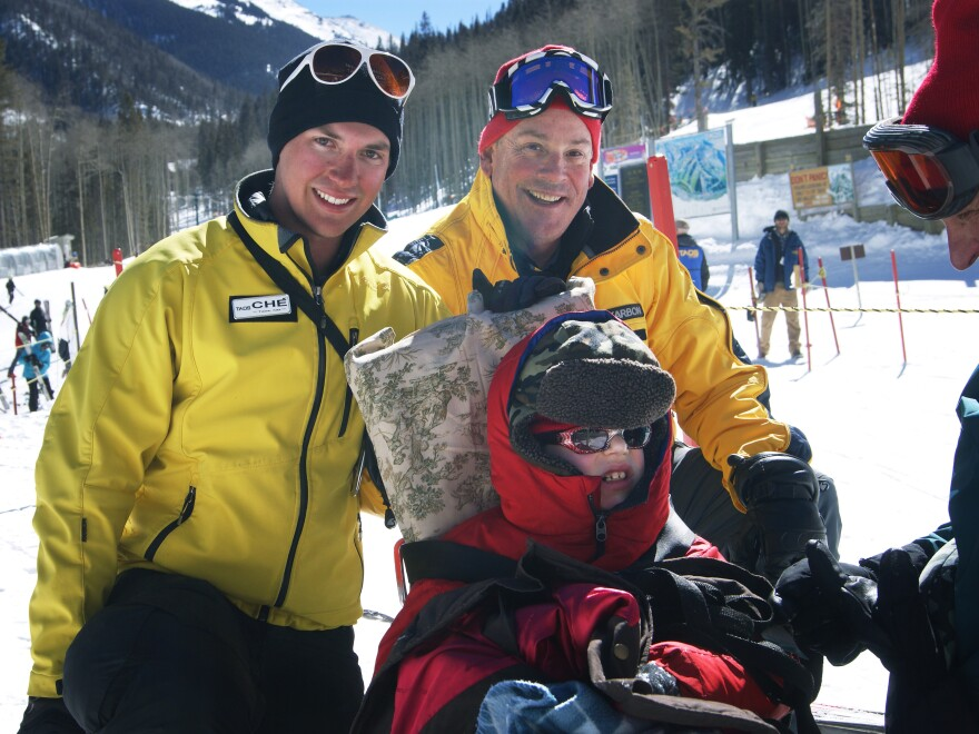 Tilghman with his instructors Ché Pirozak-Lillick (left) and Stagg after the first day of ski lessons.