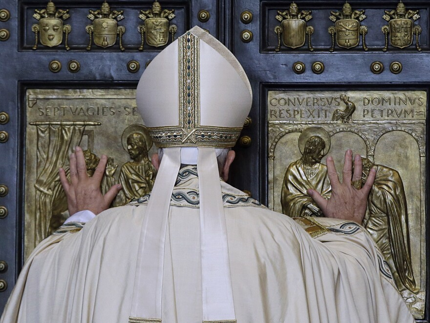 Pope Francis pushes open the Holy Door of St. Peter's Basilica, formally launching the Holy Year of Mercy, at the Vatican on Dec. 8.