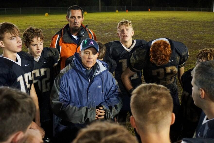 Hannan High School head football coach Kellie Thomas speaks with players following their loss to Parkersburg Catholic.
