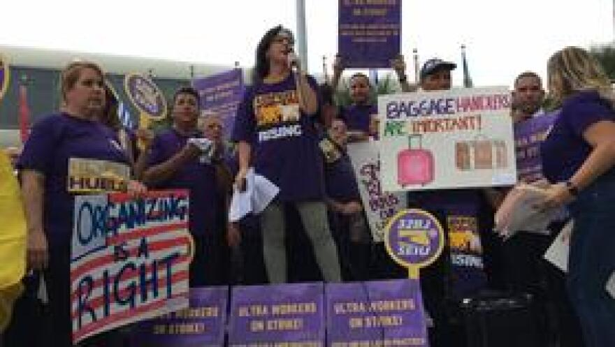 Helene O'Brien speaks at a rally against Ultra Aviation.
