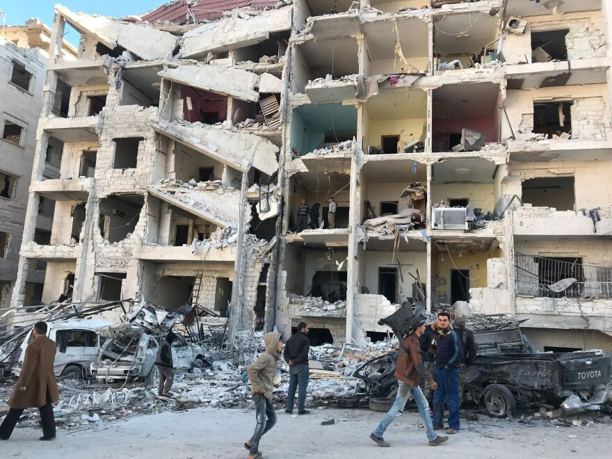 Looking at the damage in the aftermath of an explosion at in a rebel-held area of the northwestern Syrian city of Idlib on Monday.
