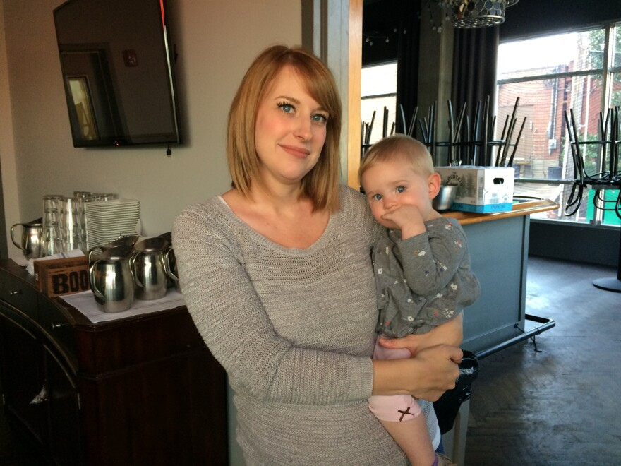 Keely Edgington and her daughter, Lula, pose inside their family-owned restaurant, Julep, in Westport. Lula was diagnosed with a neuroblastoma when she was nine months old. She's now 16 months old.