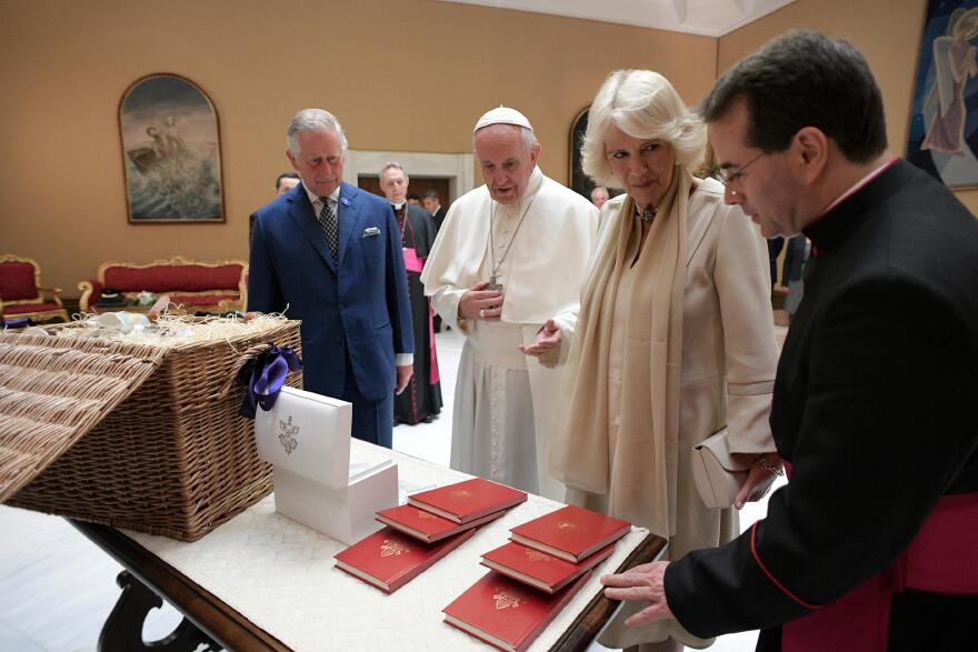 Francis exchanges gifts with Britain's Prince Charles and his wife, Camilla, Duchess of Cornwall, during a private audience at the Vatican last month.