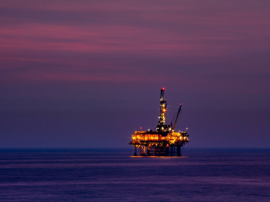 Drilling rig at purple dusk