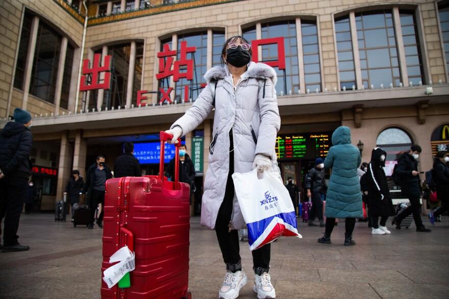 Returning home after Lunar New Year, travelers exit the Beijing train station.
