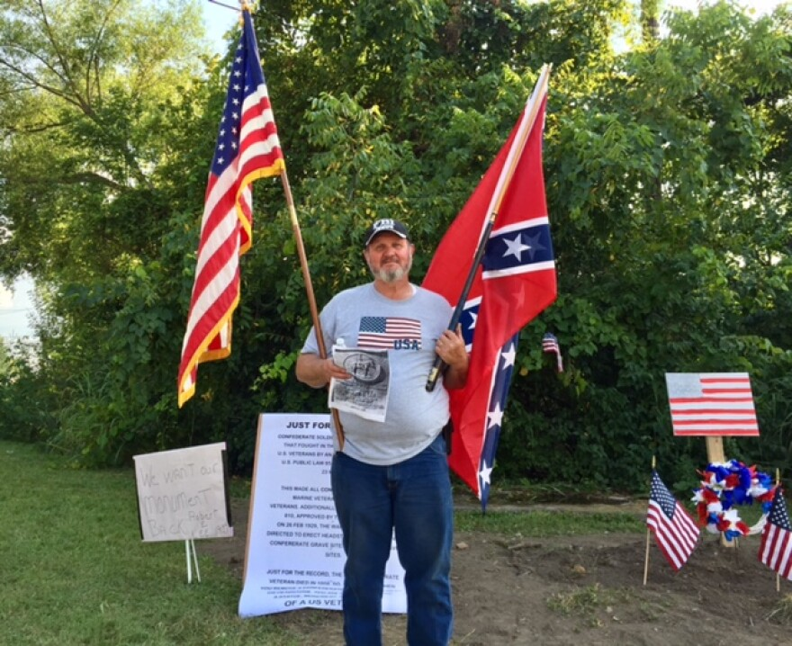 Some Franklin residents waved Confederate flags at a rally Aug. 19, 2017, at the former site of a Confederate plaque. Some residents are expressing anger over the monument's removal overnight by the city of Franklin, citing public safety concerns.