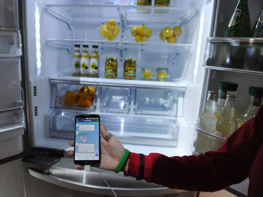An LG representative shows off a smart refrigerator at the 2014 International Consumer Electronics Show in Las Vegas on Jan. 10.
