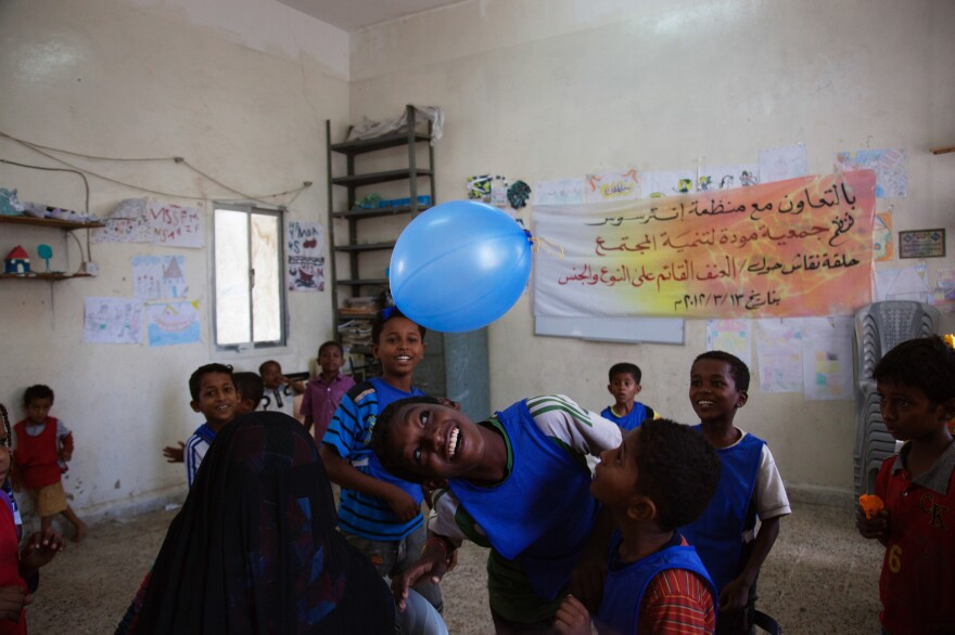 These kids are Yemenis without a home. Fighting between government and rebel forces caused their families to flee to a refugee camp in Aden, where the youngsters find time for fun.