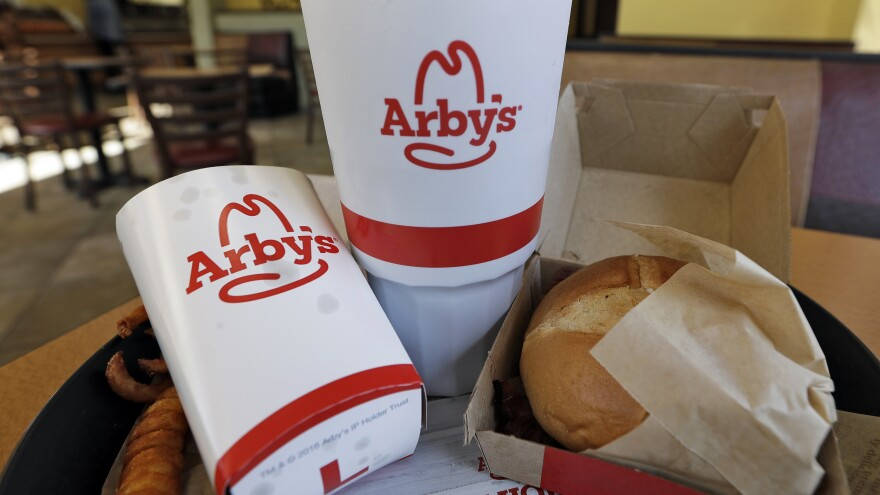 Arby's says it will pay more than $2.4 billion in cash to purchase Buffalo Wild Wings. The deal will need the approval of Buffalo Wild Wings shareholders.