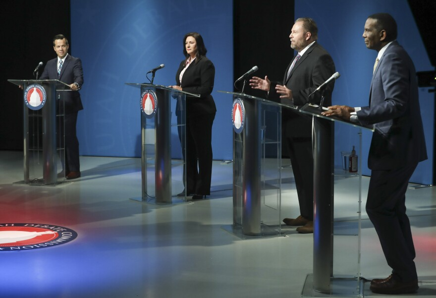 Photo of the candidates standing behind podiums