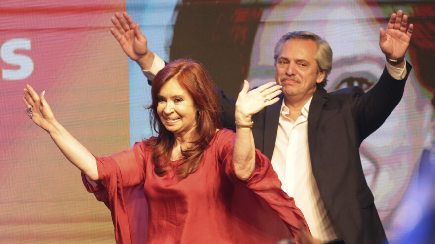 Peronist presidential candidate Alberto Fernández and his running mate, former President Cristina Fernández de Kirchner, wave to supporters in Buenos Aires, Argentina, after incumbent President Mauricio Macri conceded defeat at the end of election day, on Sunday.