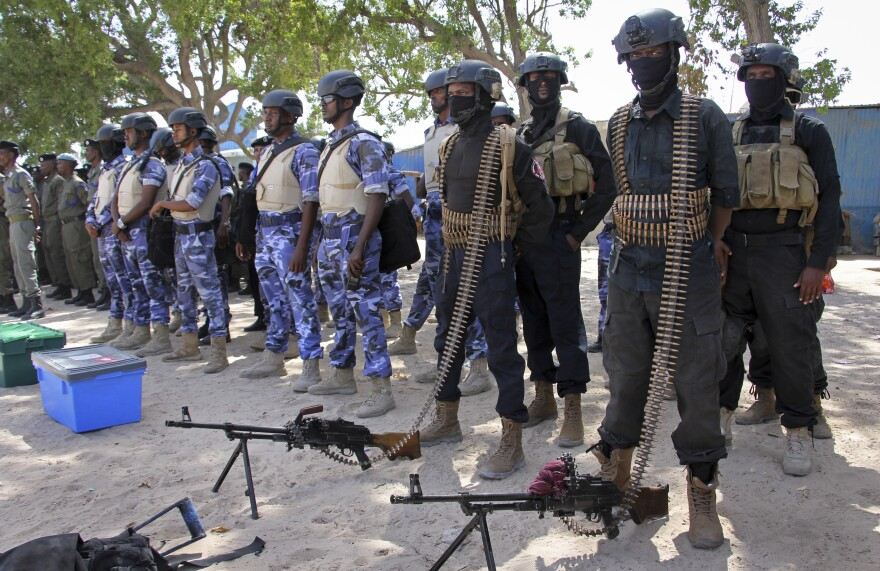 Somali soldiers prepare to secure the Somali capital of Mogadishu on Tuesday, on the eve of presidential elections.