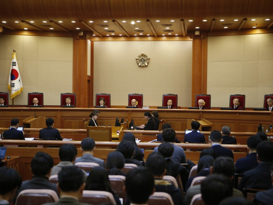 South Korea's Constitutional Court closed the first impeachment hearing for President Park Geun-hye because of her absence. A lawyer for Park indicated that his client is unlikely to testify.