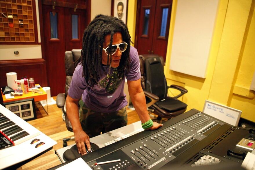 Puerto Rican hip-hop artist Tego Calderón is seen in his studio, El Sitio, in Santurce, San Juan, Puerto Rico. Behind him, a portrait of Ismael Rivera.