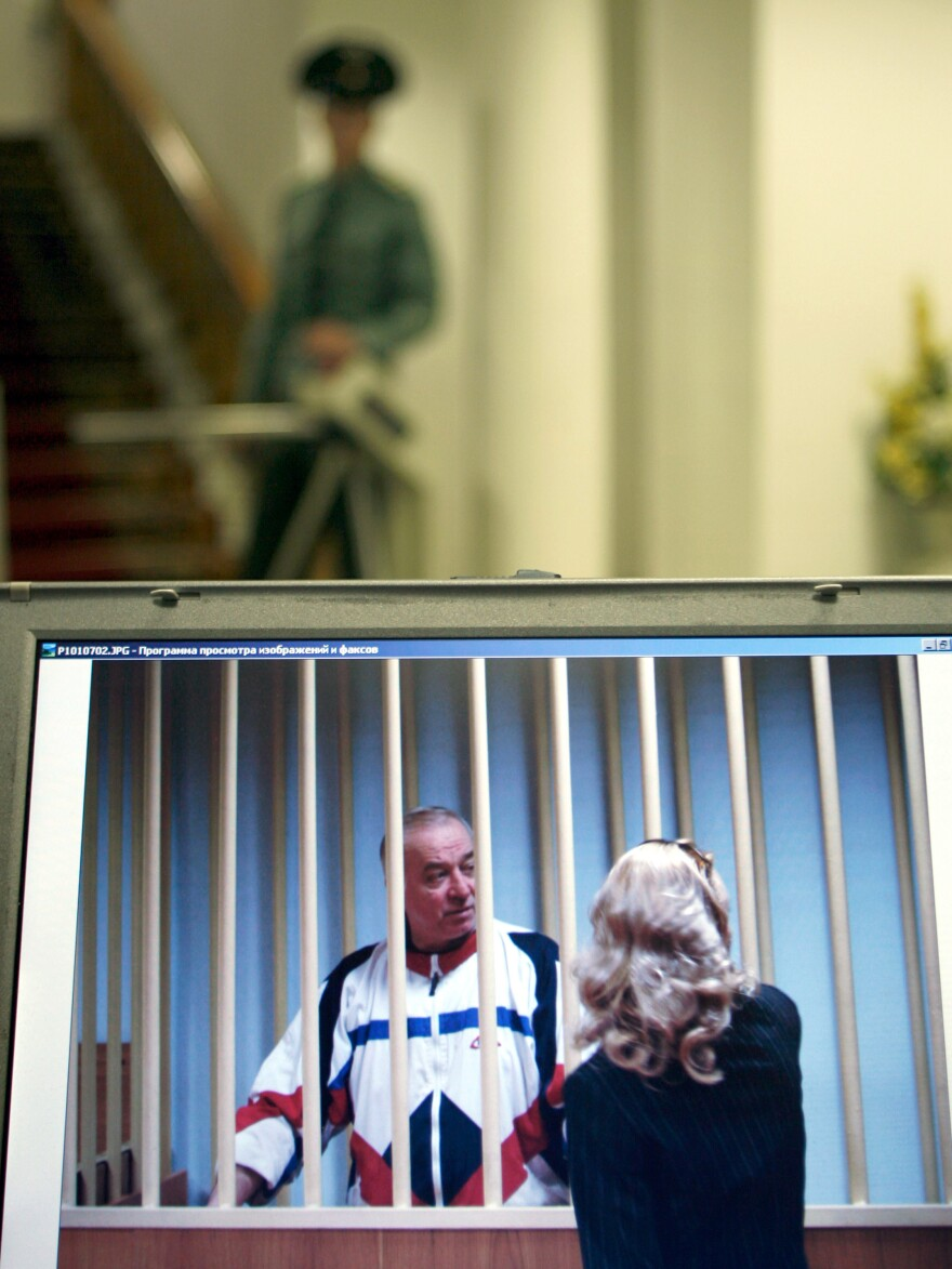 A monitor outside a courtroom shows Sergei Skripal speaking to his lawyer from behind bars in Moscow in 2006. Skripal is a retired Russian colonel recruited by British intelligence in the mid-1990s.