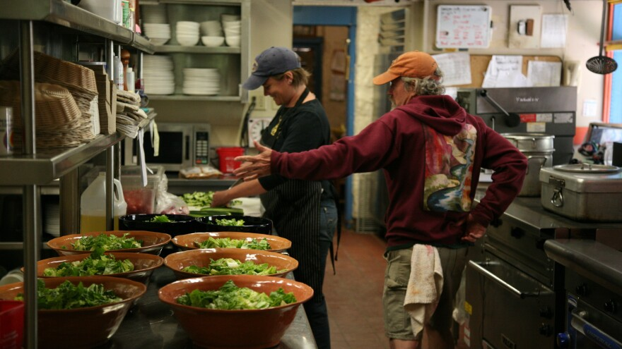 LeeAnn Dodde, left, and Brian Couch work at Phantom Ranch. The kitchen is constantly humming, with breakfast cooks coming in during the wee morning hours, and evening cooks grilling up steaks and ladling seemingly unending pots of stew.