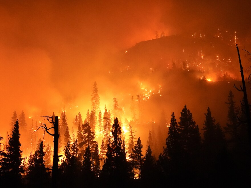 The Creek Fire burns in the Sierra National Forest on Sunday.