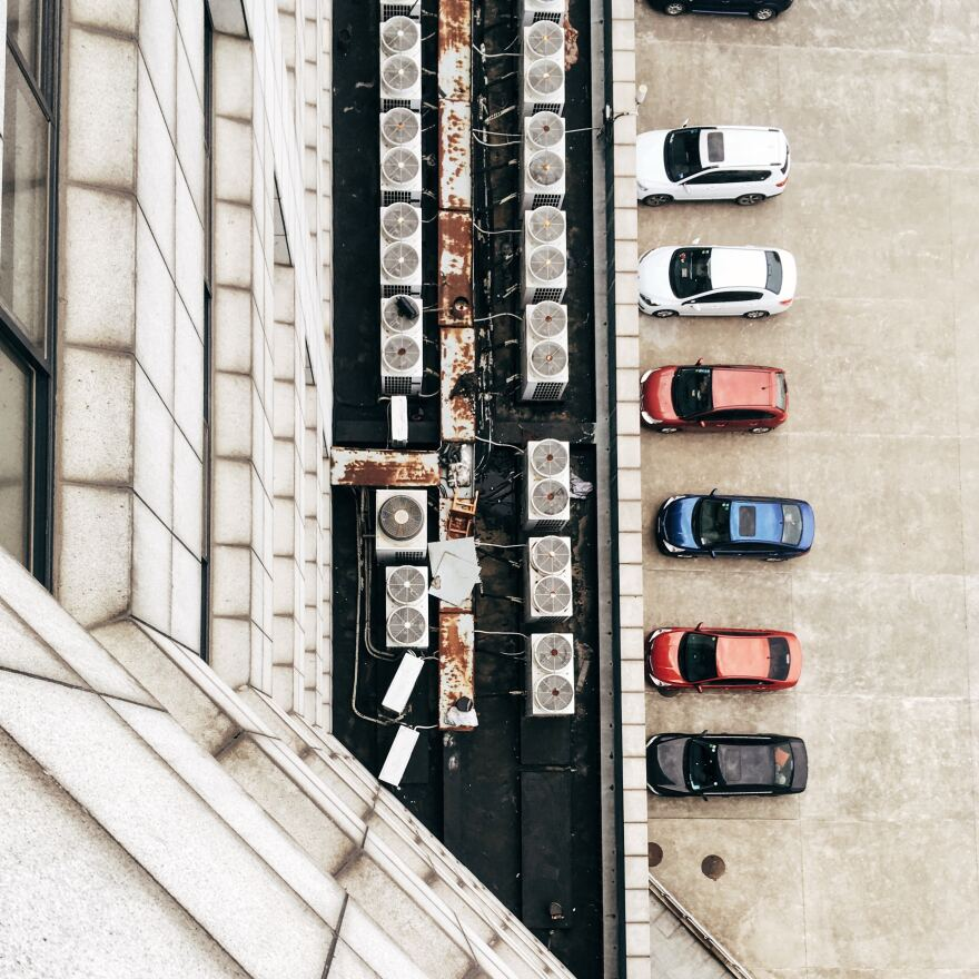 row of parked cars in parking garage