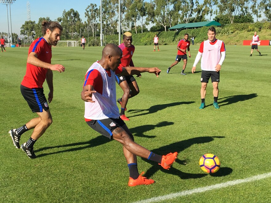 Darlington Nagbe of the MLS' Portland Timbers passes to a teammate during a scrimmage at the U.S. men's national team January training camp in Carson, Calif. Closing in on Nagbe from behind is USMNT member Graham Zusi, who played in the 2014 World Cup in Brazil.