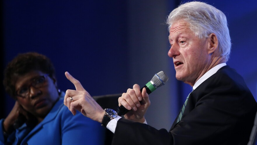 Former President Bill Clinton answers questions Wednesday from Gwen Ifill of <em>PBS NewsHour</em> at the 2014 Fiscal Summit organized by the Peter G. Peterson Foundation in Washington.
