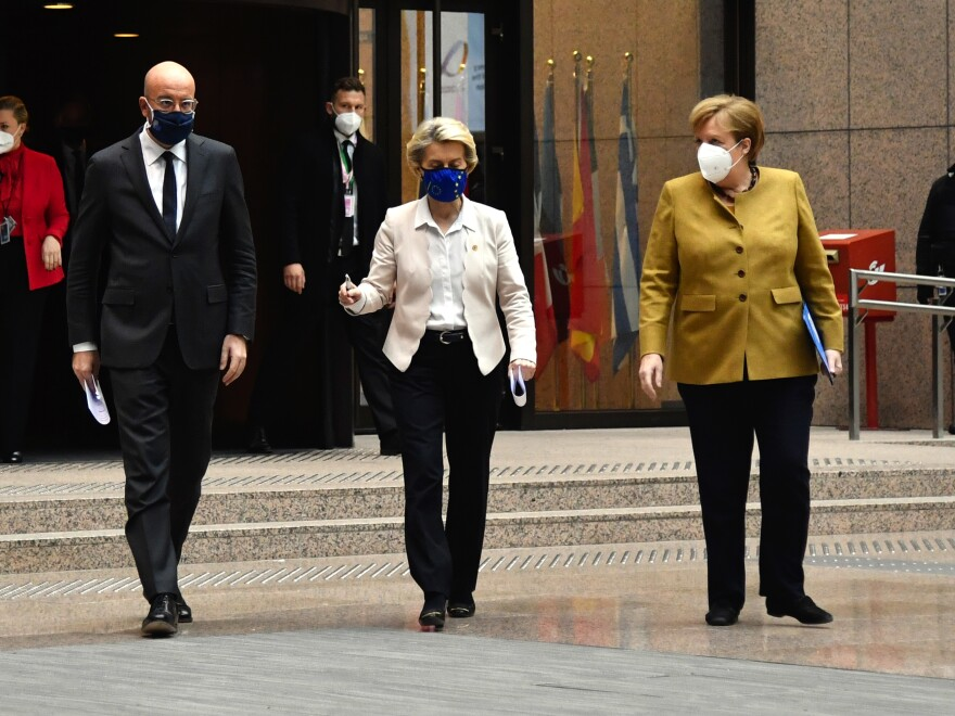 Charles Michel, president of the European Council (left), Ursula von der Leyen, president of the European Commission (center) and Angela Merkel, Germany's chancellor, wear protective face masks as they walk to a news conference at a European Union (EU) leaders summit Friday in Brussels.