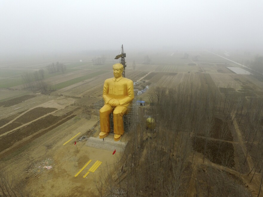 A giant statue of late Chairman Mao Zedong was under construction Monday near crop fields in a village in Tongxu county in China's Henan province.