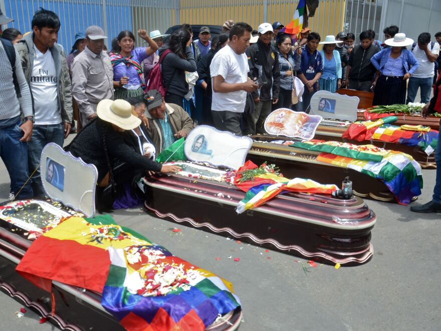 Relatives mourn by the coffins of supporters of Evo Morales killed during clashes with the police in Sacaba, Cochabamba, Bolivia, on Nov. 16, 2019.